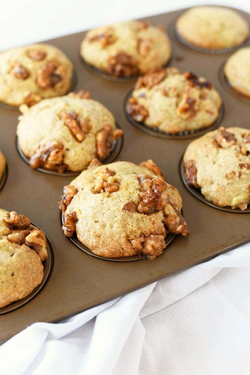 Candied Walnuts Banana Muffins in a gold muffin tin baked.