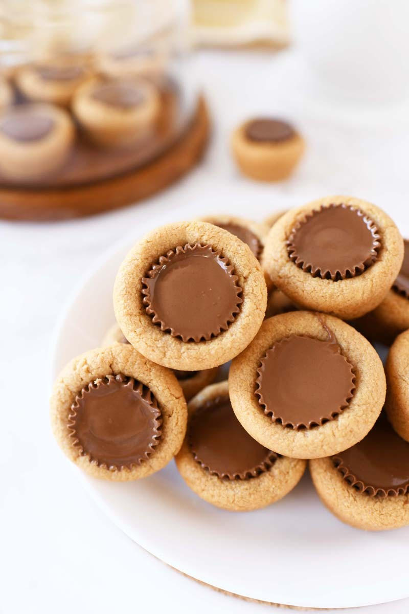 Peanut Butter Cup Cookie Cups stacked on white plate.