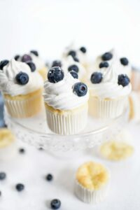 WW cupcakes recipe. Angel food cupcakes on a stand with whipped topping and fresh blueberries.