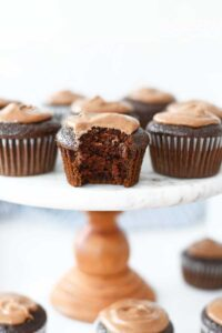Chocolate Mayonnaise Frosted cupcakes. These cupcakes are on a wood and marble cakestand.