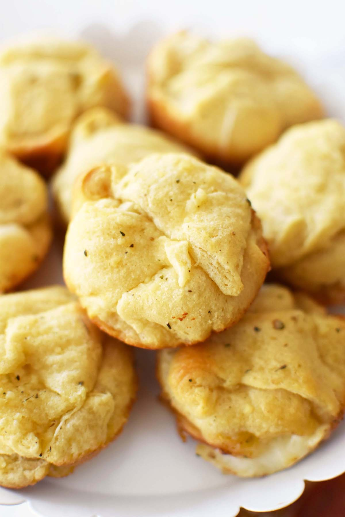 Garlic Bread Cheese Bites - Baked until golden brown and stacked on a cake stand.