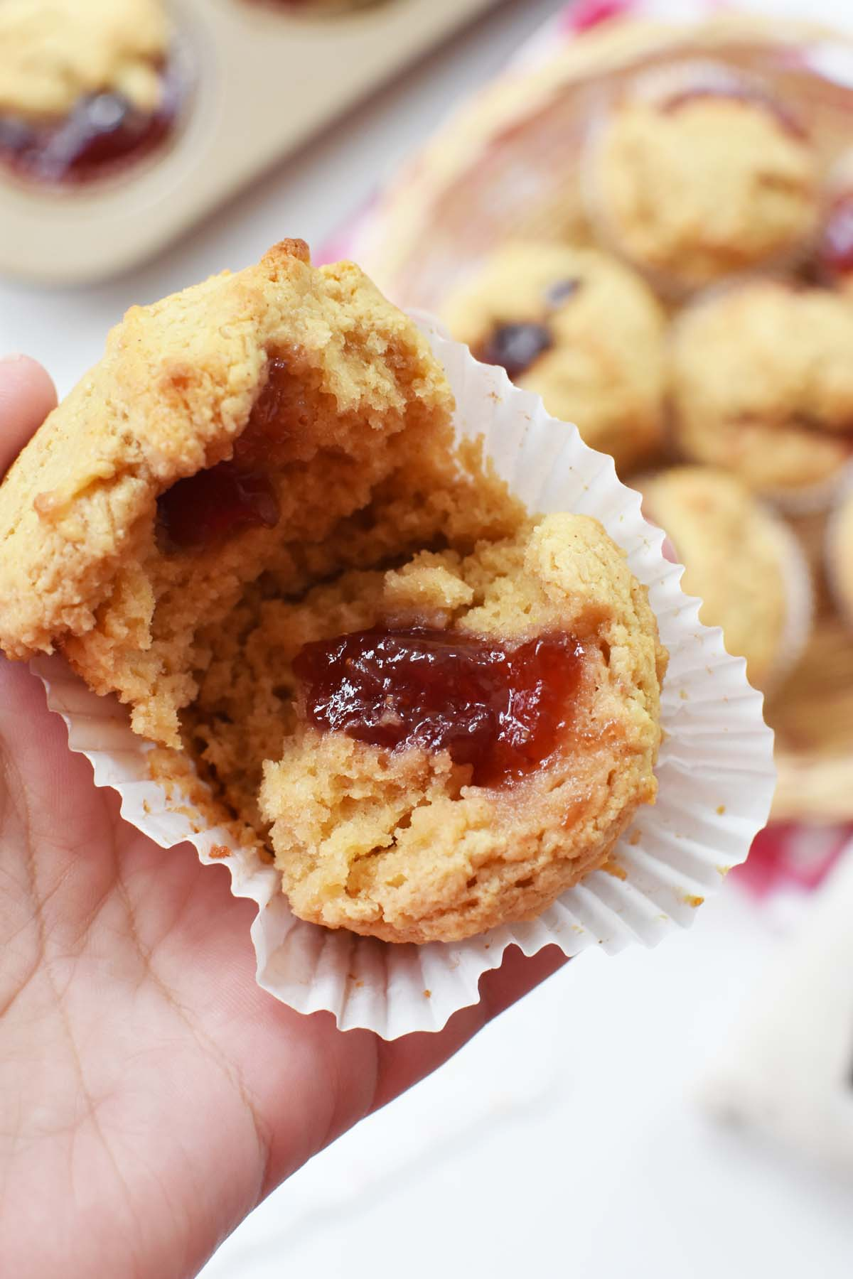 Inside a Peanut Butter and Jelly Muffin. A muffin is spread open to see the inside.