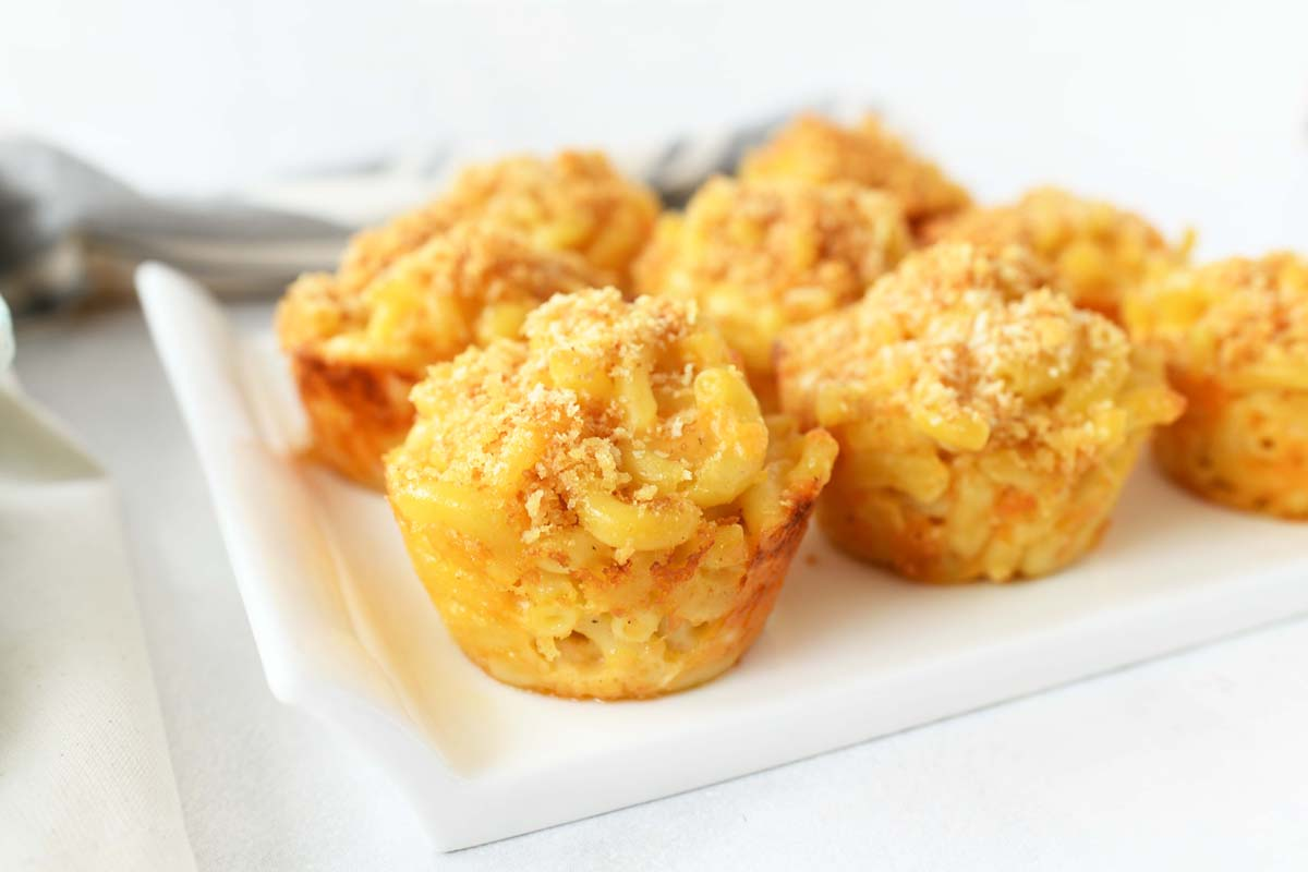 Mac & Cheese Muffins are on a white platter.