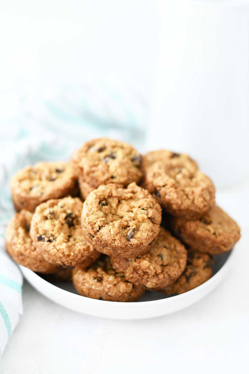 Golden Brown Oatmeal Raisin cookies in a white dish.
